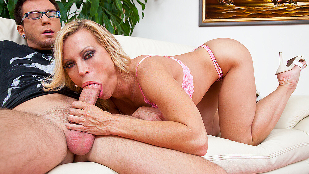 Blonde Amber Lynn fucking in the couch with her big tits