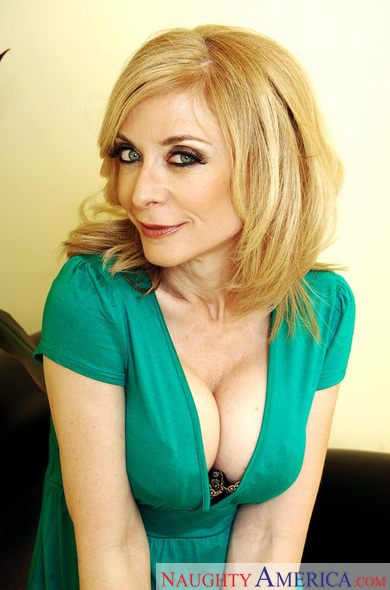 MILF Nina Hartley fucking in the bathroom with her tits