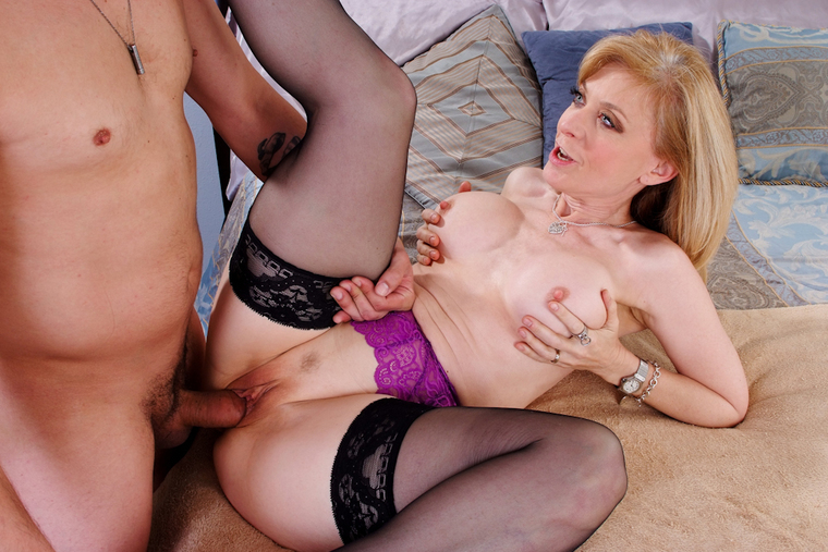 Petite Nina Hartley fucking in the bed with her petite