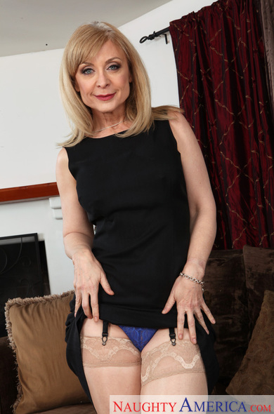 MILF Nina Hartley fucking in the couch with her lingerie