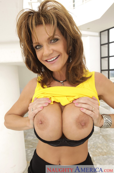 Brunette Deauxma fucking in the bed with her big tits